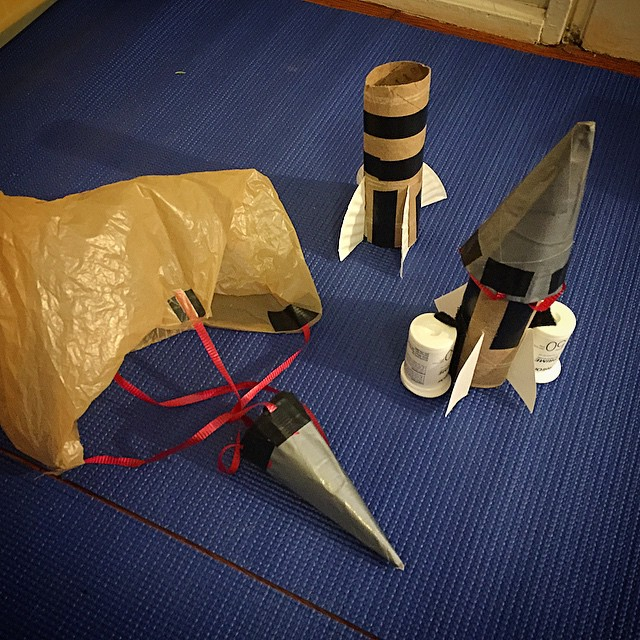 Cardboard rockets with boosters and parachutes